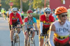 Nice telephoto shot of woman rider flanked by two male riders. royalty free stock image
