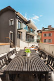 Nice terrace of modern house. Modern house, outdoor, modern garden furniture Royalty Free Stock Photo