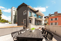 Nice terrace of modern house. Modern house, outdoor, modern garden furniture Royalty Free Stock Photography