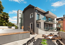 Nice terrace of modern house. Modern house, outdoor, modern garden furniture Stock Images