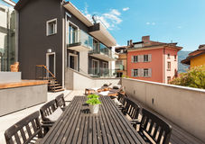 Nice terrace of modern house. Modern house, outdoor, modern garden furniture Royalty Free Stock Images