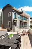 Nice terrace of modern house. Modern house, outdoor, modern garden furniture Stock Image