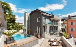 Nice terrace of modern house. Modern house, outdoor, modern garden furniture Royalty Free Stock Photos