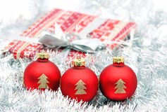 Nice three red christmas ball and present Stock Image