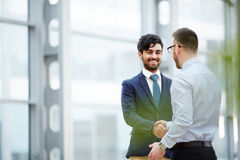 Nice to meet you. Happy businessman greeting new co-worker after introducing Royalty Free Stock Image