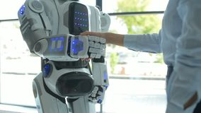 Close up of robot and girl shaking hands stock footage
