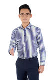 Nice to meet you. Unsmiling young Asian businessman stretching out his hand to greet you Stock Photo
