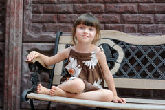 Nice toddler girl on bench Stock Photography