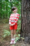Nice toddler girl in cute shorts and stripe sweate Royalty Free Stock Photo