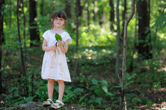 Nice toddler girl in the summer forest Royalty Free Stock Image