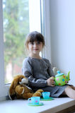 Nice toddler girl with toy tea set and bunny Royalty Free Stock Photos