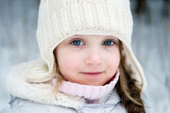 Nice  toddler girl in  white winter hat Royalty Free Stock Photos