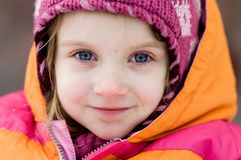 Nice toddler girl in winter pink hat Royalty Free Stock Image