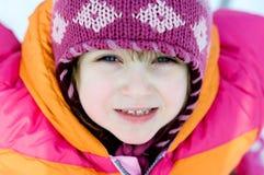 Nice toddler girl in winter pink hat Royalty Free Stock Image