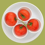 Nice tomato composition. Nice red tomato, fruits in white beakers, clipping path Royalty Free Stock Photography