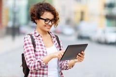 Nice tourist holding laptop Stock Photos