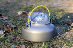 Nice tourist kettle on meadow Royalty Free Stock Images