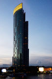 Nice tower building beside Chao Phraya river Royalty Free Stock Photos