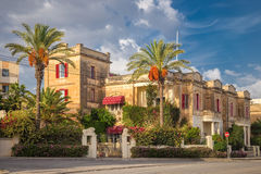 Nice traditional building at Valletta with palm trees - Malta Royalty Free Stock Photo