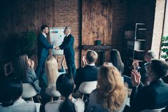Nice trendy stylish elegant sharks marketers manages ceo boss chief conference shaking hands welcome to start-up project. At modern industrial loft interior royalty free stock photography