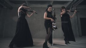Nice trio of violinist girls. A wonderful instrumental trio. Girls in black. stock footage