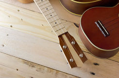 Nice ukuleles with copy space on the left area. Ukeleles on the wooden deck in warm color tone Royalty Free Stock Photos