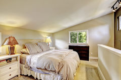 Nice upstairs bedroom with king size bed and vaulted ceiling. Stock Images
