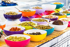 Nice various olive dishes. Perspective view of various colorful dishes of olive Royalty Free Stock Image