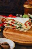 Nice vegetarian quesadilla with tortilla bread, beans, cheese and vegetables. Stock Photography