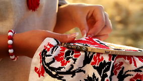 Nice video of ethnic traditions , she embroiders the ornament stock footage