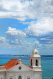 Nice view. View of Lisbon blues sky and a roof with cross Stock Photo