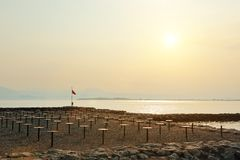 Nice view of a beach on Lake Garda at sunset Royalty Free Stock Photo