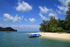 Nice view with beach and sand. Beautiful beach with tree and boat Royalty Free Stock Photos