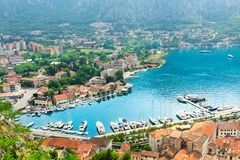 Nice view of blue sea and mountains. Nice view of harbor with buildings. Kotor, Montenegro Stock Photos
