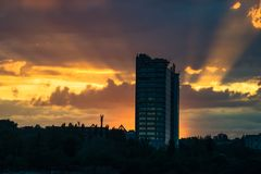 Nice view city landscape on sunset flares of sun. Nature city life Royalty Free Stock Photography
