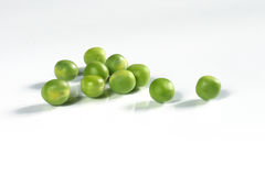 Nice view of green peas. On the white background Royalty Free Stock Photo