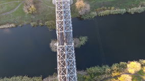 Nice view from the height of the railway bridge and the river, flying drones over the railway bridge and the railway. The view from the height on the railroad stock video footage