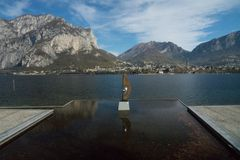 View of lecco. A nice view of Lecco city from Malgrate, On the Lake of Como.A sculpture Eye of Light taken in november 2018 Royalty Free Stock Photo