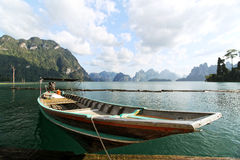 Nice view and long-tailed boat at Ratchaprapha Dam. Suratthani, Thailand Royalty Free Stock Image