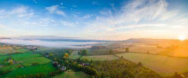 Over the fields in UK... Nice view over the fields in UK with sunrise in action royalty free stock photos