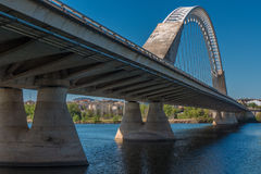 A nice view on the perspective of the Lusitana bridge. Beautiful modern bridge over the Guadiana river, in Merida, Spain Royalty Free Stock Photo