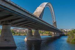 A nice view on the perspective of the Lusitana bridge. Beautiful modern bridge over the Guadiana river, in Merida, Spain Royalty Free Stock Image