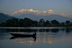 Nice view in pokhara Nepal from the lake. Nice view from Phewa Lake Pokhara to the peak called fishtail. A boat just going around in the lake Stock Image