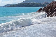 Nice view of the sea. Large foamy waves. The sea on a sunny day. Adriatic Sea. Montenegro.  Royalty Free Stock Image
