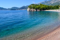 Nice view of the sea. The mountains descend into the sea. The mountains are covered with forests. Beautiful Lagoon. Adriatic Sea. Montenegro royalty free stock photo