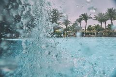 Swimming pool. Nice view of the swimming pool with waterfall Stock Photography