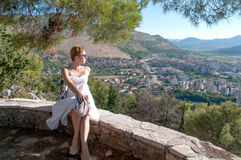 Nice viewpoint. Woman looking down at the City of Trebinje, Bosnia and Hercegovina Royalty Free Stock Images