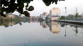 Nice water side. Nice village near a pond Stock Photography