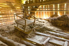 Nice vintage sledge in the attic. Nice old vintage slede placed on hay in the attic Stock Image