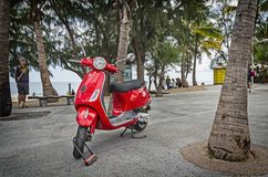 Nice vivid red scooter Royalty Free Stock Photos